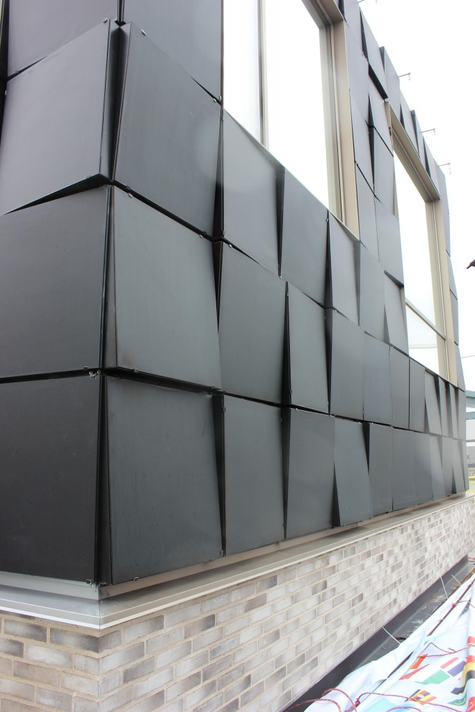 The solar panel facade is a crucial part of the sustainable building