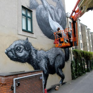 ROA who is originally from Belgium is decorating  Gasværksvej 34 with his world famous motives of giant animals, in this case both squirrels and birds (photo: Øksnehallen Facebook page)