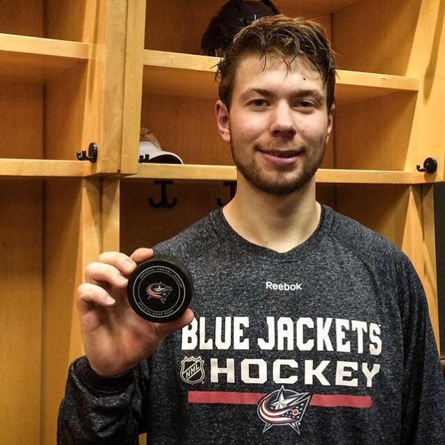 Bjorkstrand shows off his first goal puck last month (photo: Oliver Bjorkstrand)
