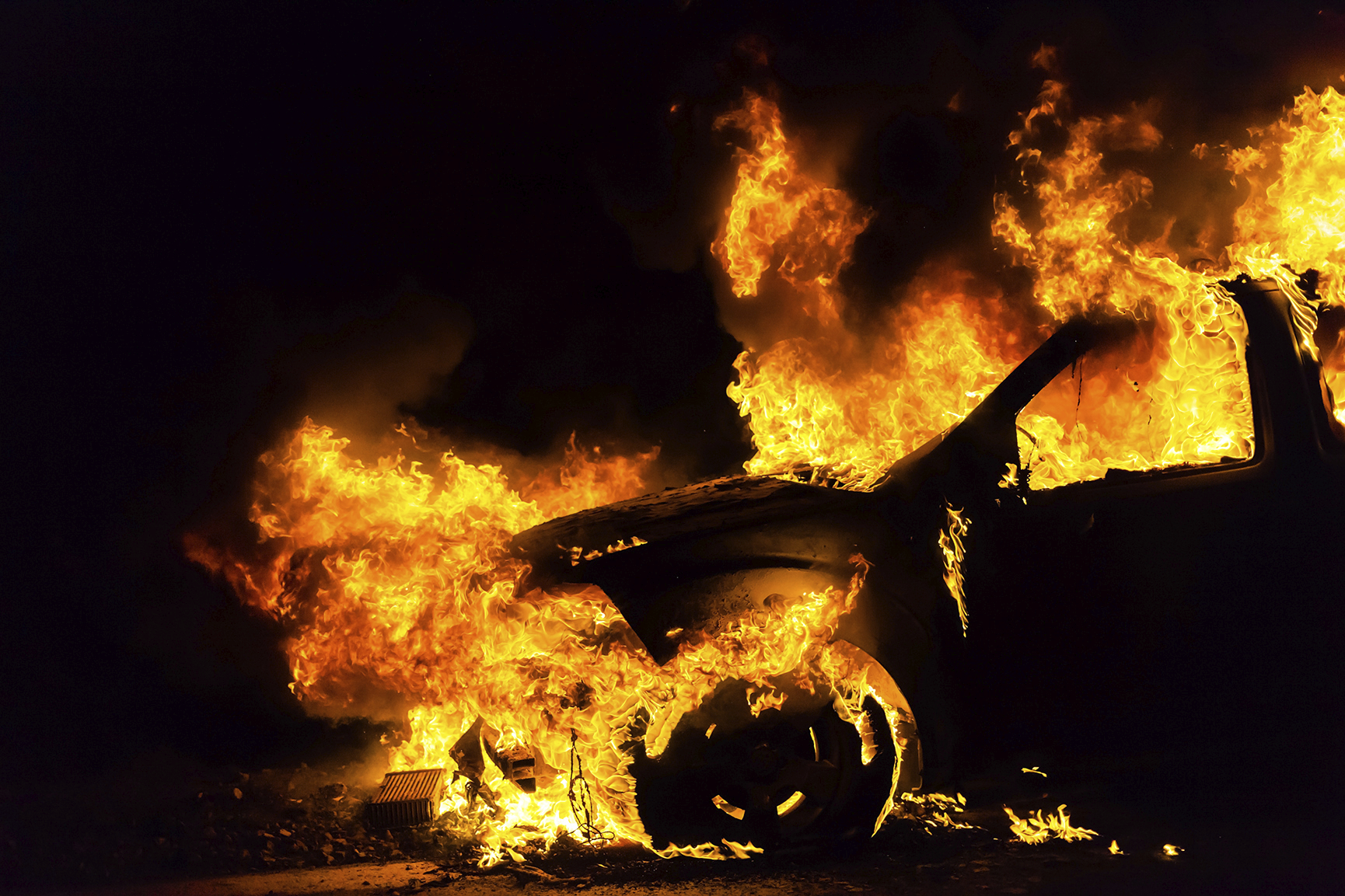 Behind the burning cars, something else is smouldering (photo: iStock)